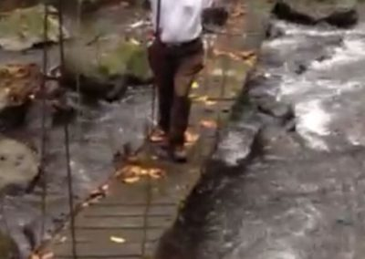 Michael Zuffolo crossing a rushing river